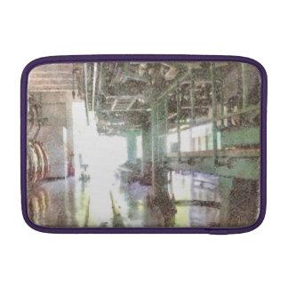 Machinery in a factory MacBook air sleeves
