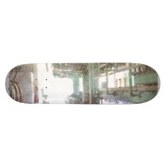 Machinery in a factory skate board deck