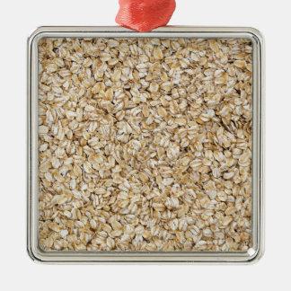 Macro de la harina de avena como estructura del adorno navideño cuadrado de metal