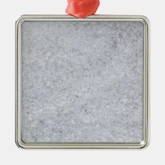 Macro de la sal como estructura del fondo adorno navideño cuadrado de metal