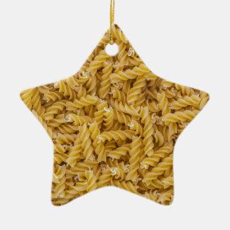 Macro de las pastas de Fusilli como estructura del Adorno Navideño De Cerámica En Forma De Estrella