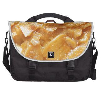 Macro of almond splitters on a cake laptop bag