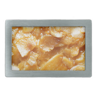 Macro of almond splitters on a cake rectangular belt buckle