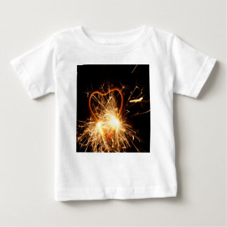 Macro photo of a burning sparkler in form of a hea baby T-Shirt