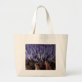 Macro photo of blue artichoke flower leaves. large tote bag