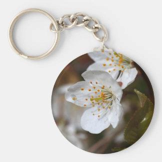 macro photo of cherry flowers keychain
