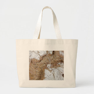 Macro photo of the surface of brown bread large tote bag