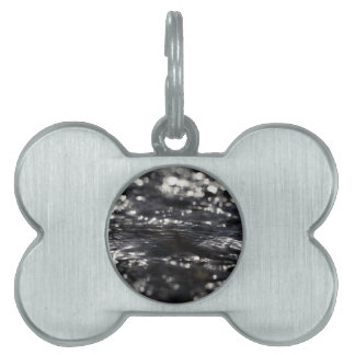 Macro photo of the surface of water in a creek pet tag