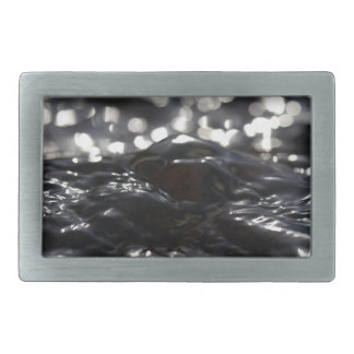 Macro photo of the surface of water in a creek rectangular belt buckle