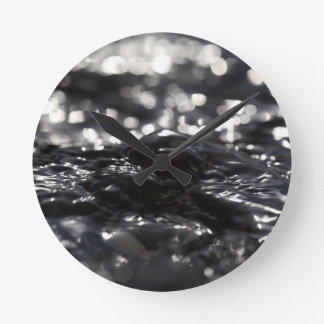 Macro photo of the surface of water in a creek round clock