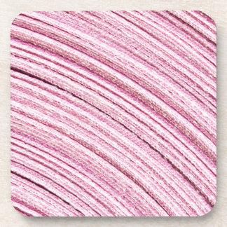 Macro rosada de la cinta posavasos de bebidas