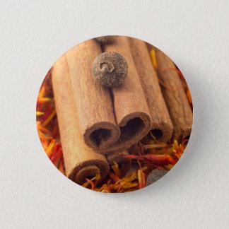 Macro view of the cinnamone, peppercorn and saffro button