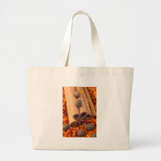 Macro view of the cinnamone, peppercorn and saffro large tote bag