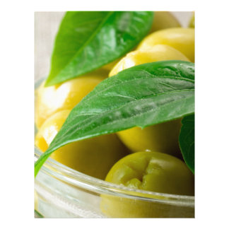 Macro view of the olives with green leaves closeup letterhead