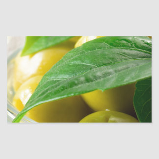 Macro view of the olives with green leaves closeup rectangular sticker