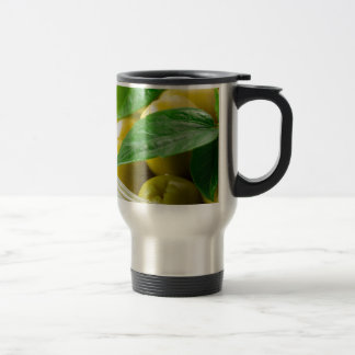 Macro view of the olives with green leaves closeup travel mug