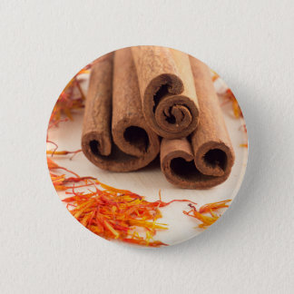 Macro view of the sticks of cinnamon and saffron pinback button