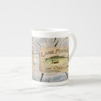 Madera baja de la cabina de la pesca de la orilla taza de porcelana