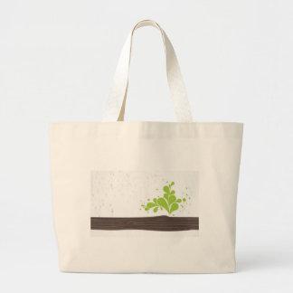 Madera con la hoja verde bolsas