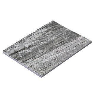 Madera resistida del granero con el clavo cuadernos