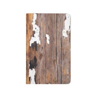 Madera resistida vieja cuadernos grapados