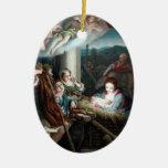 Madonna y niño en pesebre adorno navideño ovalado de cerámica