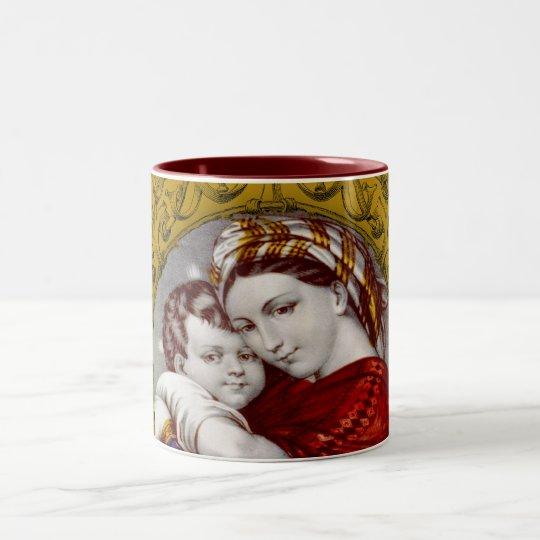 Madonna y taza de café del niño