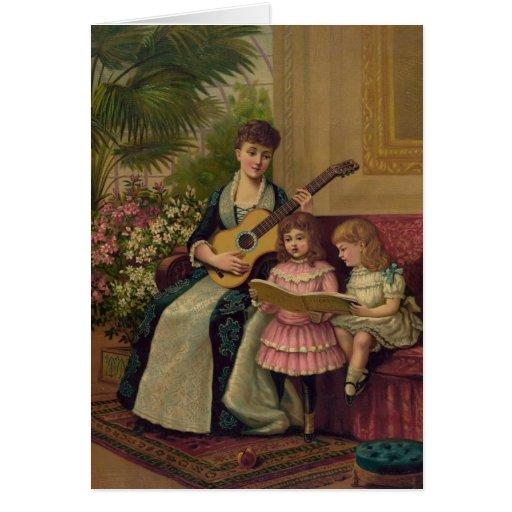Madre del vintage con la guitarra y los niños tarjeta