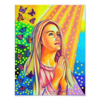 Madre Maria que ruega con la luz desde arriba Fotografía