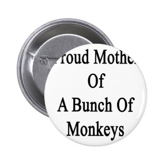 Madre orgullosa de un manojo de monos pin redondo de 2 pulgadas