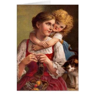 Madre que hace punto con el niño y el gato tarjeta de felicitación