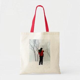 Madre y niño escena del invierno bolsas lienzo