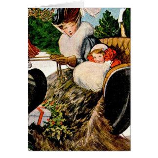 Madre y niño sleighing tarjeta de felicitación