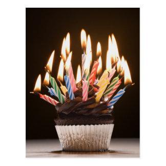 Magdalena con las velas del cumpleaños postal