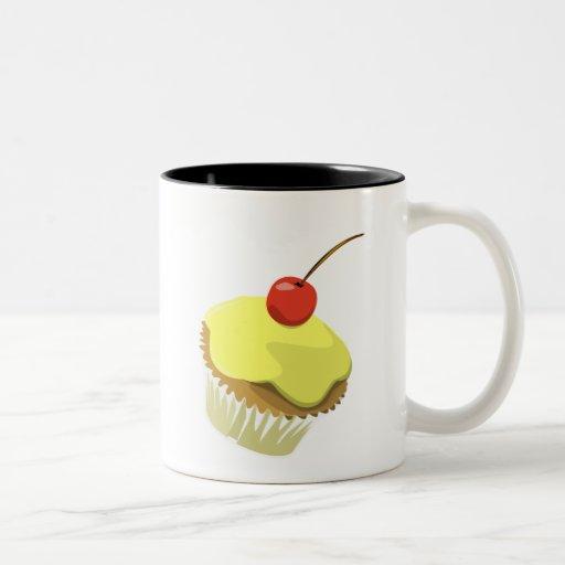 Magdalena del limón con la taza de la cereza