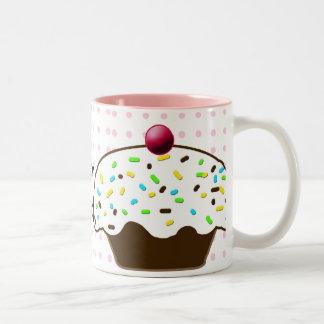 magdalenas dulces taza de café de dos colores
