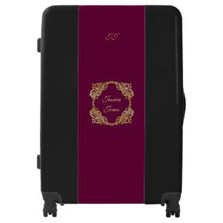 Magenta and black monogram luggage trolley