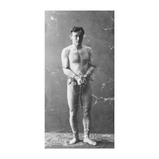 Magician Harry Houdini Standing In Chains Canvas Print