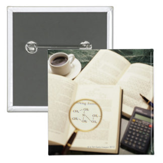 Magnifying glass enlarging molecular diagram 2 inch square button
