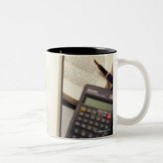 Magnifying glass enlarging molecular diagram Two-Tone coffee mug