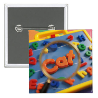 Magnifying glass enlarging view of word CAT 2 Inch Square Button