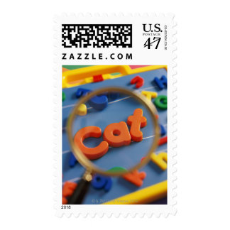 Magnifying glass enlarging view of word CAT Postage Stamp