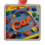 Magnifying glass enlarging view of word CAT Square Metal Christmas Ornament