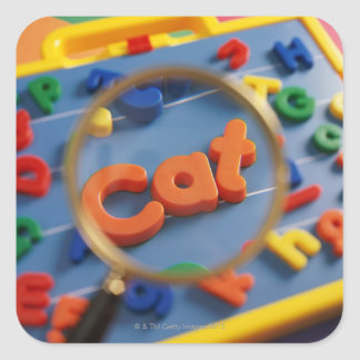 Magnifying glass enlarging view of word CAT Square Sticker