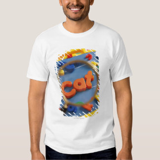 Magnifying glass enlarging view of word CAT T Shirts