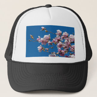 magnolia flower on tree trucker hat