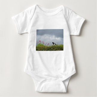 Magpie and wild flowers. baby bodysuit