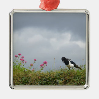 Magpie and wild flowers. metal ornament