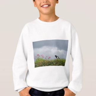 Magpie and wild flowers. sweatshirt