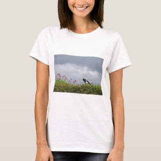 Magpie and wild flowers. T-Shirt